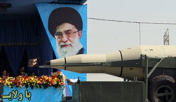 A truck carrying an Iranian Sejil medium-range missile during a military parade in Tehran