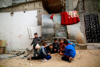 Palestinians children play outside a house in the al-Shati refugee camp in Gaza City on January 4, 2018