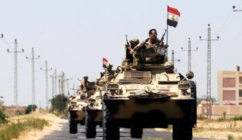 Soldiers in military vehicles in Sinai, 2013.