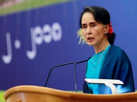 Myanmar's leader Aung San Suu Kyi smiles as she delivers a speech during a ceremony to mark the second year anniversary of the parliament in Naypyitaw, Myanmar, Thursday, Feb. 1, 2018.