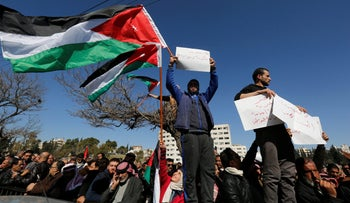Protesters are seen in front of parliament in Amman, Jordan February 1, 2018. The sign reads 'Go away government and deputies.'