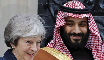 Britain's Prime Minister Theresa May (L) greets Saudi Arabia's Crown Prince Mohammed bin Salman (R) outside 10 Downing Street, in central London on March 7, 2018