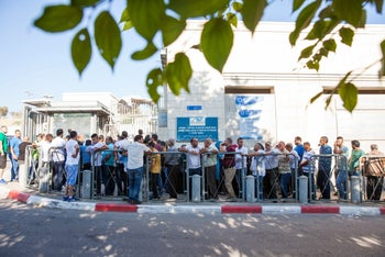 A line forming outside the Population, Immigration and Border Authority office in East Jerusalem, May 2017.