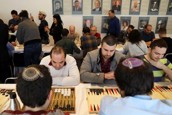 FILE PHOTO: Players participate in a backgammon tournament organized by Double Yerushalmi, a group trying to enhance ties between Arabs and Jews through cultural activities, in Jerusalem, Jan 30, 2018