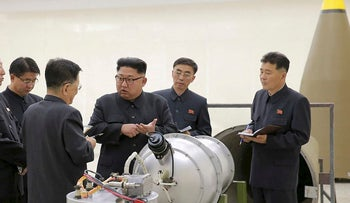 North Korean leader Kim Jong Un provides guidance with Ri Hong Sop (3rd L) and Hong Sung Mu (L) on a nuclear weapons program in this undated photo released by North Korea's Korean Central News Agency (KCNA) in Pyongyang September 3, 2017