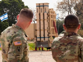 """U.S. soldiers stand near a David's Sling, an Israeli anti-missile system during a joint Israeli-US military exercise """"Juniper Cobra"""" at the Hatzor Airforce Base, March 8, 2018."""