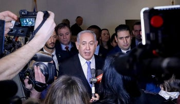 Prime Minister Benjamin Netanyahu  speaks to the press during the opening of a special exhibit on Jewish presence in Jerusalem at the United Nations Headquarters in New York City, U.S., March 8, 2018.