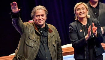 Marine Le Pen (R) applauds former US President advisor Steve Bannon after his speech during the Front National party annual congress in Lille, northern France. March 10, 2018.