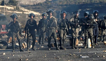 Border Police officers taking position during clashes with Palestinians near the settlements of Beit Eli, close to Ramallah.