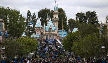 FILE PHOTO: People are seen on the Main Street during Disneyland's Diamond Celebration in Anaheim, California May 22, 2015.