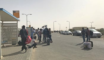 African asylum seekers waiting at a bus station outside the Saharonim detention facility.