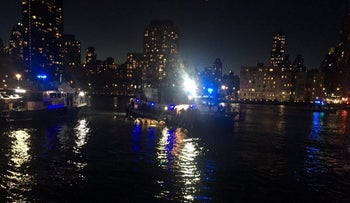 This image made from video provided by the New York City Police Department shows the scene of a helicopter crash in the East River in New York on Sunday, March 11, 2018.