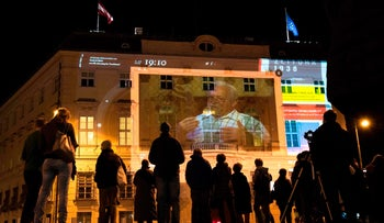 Austria marks the 80th anniversary of its annexation by Nazi Germany with a projection on the facade of the Austrian Chancellery, March 12, 2018.