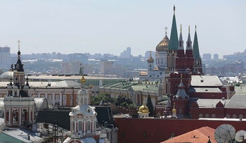 Residential and commercial buildings stand on the city skyline seen from the roof of the Central Children's Mall in Moscow, Russia, on Monday, June 8, 2015
