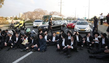 Members of the 'Jerusalem Faction' protest the arrest of a yeshiva student for draft dodging, near Bnei Brak, Israel, March 12, 2018.