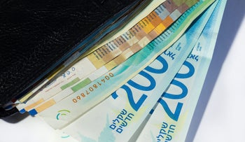 Shekels in a wallet.