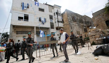 Israeli border police officers are seen in front of a contested building in the West Bank city of Hebron, July 26, 2017.