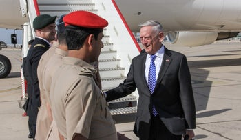 FILE PHOTO: U.S. Secretary for Defense Jim Mattis shakes hands with Omani officials upon his arrival in the capital Muscat, March 11, 2018.