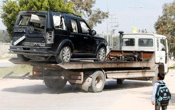 A damaged vehicle of the convoy of Palestinian Prime Minister Rami Hamdallah is removed after an explosion in the northern Gaza Strip March 13, 2018