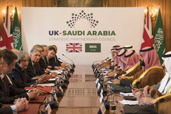 Saudi Crown Prince Mohammed bin Salman, 2nd right, conducts a meeting with Britain's Prime Minister Theresa May, 2nd left, with other members of their delegations, inside 10 Downing Street, London, on Wednesday March 7, 2018.