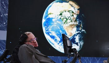 Physicist Stephen Hawking sits on stage during an announcement of the Breakthrough Starshot initiative with investor Yuri Milner in New York April 12, 2016.