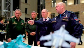 Russian President Vladimir Putin, second right, Russian Defense Minister Sergey Shoigu, left, and Chief of the General Staff of the Russian Armed Forces Valery Gerasimov, second left, in Moscow, Russia, Tuesday, Jan. 30, 2018.
