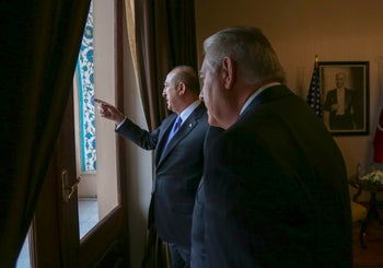 Turkey's Foreign Minister Mevlut Cavusoglu, left, points as U.S. Secretary of State Rex Tillerson, left, looks on, prior to their meeting in Ankara, Turkey, Friday, Feb. 16, 2018