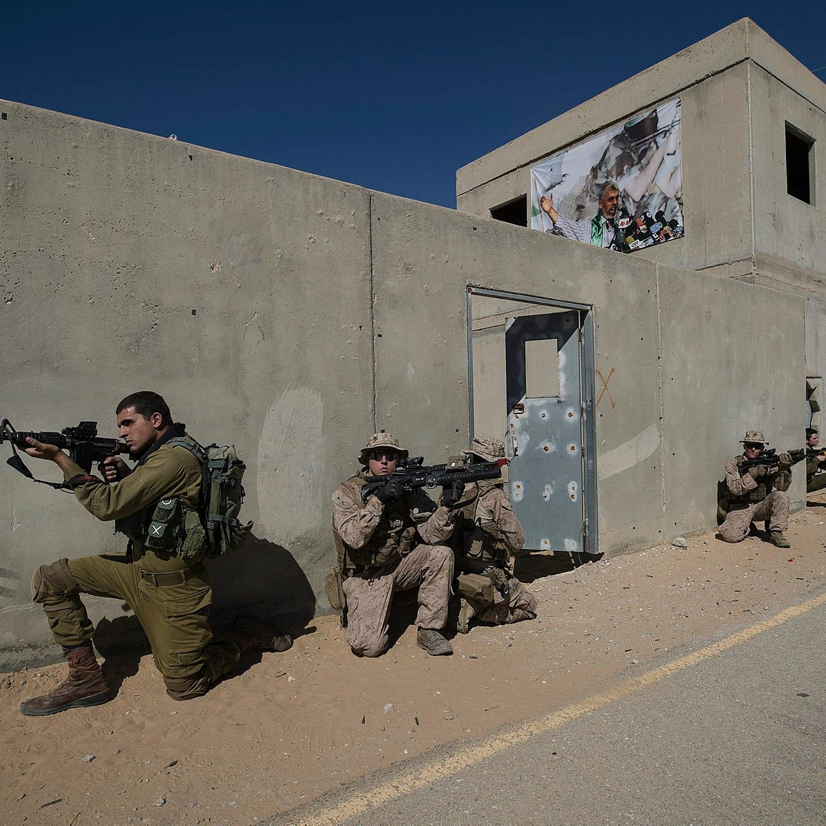 In this Monday, March 12, 2018 photo, U.S. Marines and a Israeli soldiers take part in a joint urban warfare exercise at the Mala base, south of Israel. U.S. and Israeli forces are preparing to one day fight alongside one another to defend Israel against missile attacks from across the region.