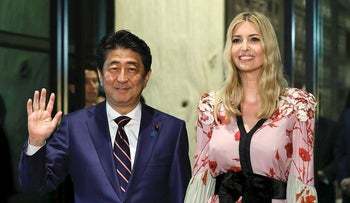 Shinzo Abe, Japan's prime minister, left, and Ivanka Trump, assistant to U.S. President Donald Trump, pose for photographers as they arrive for a dinner in Tokyo, Japan, on Friday, Nov. 3, 2017