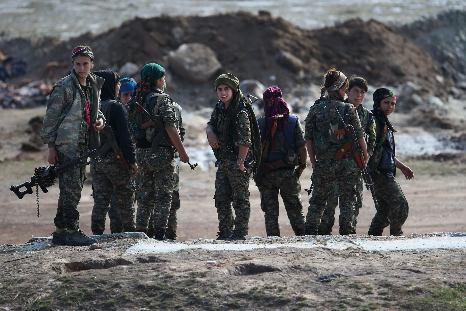 Female troops from the Syrian Democratic Forces discuss frontline positions from a forward operating base on November 10, 2015, in the autonomous region of Rojava, Syria.