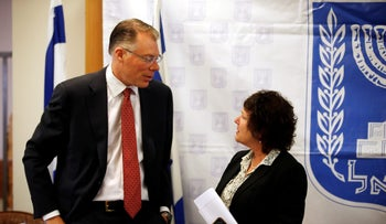 Craig Beaumont, IMF Mission Chief for Israel, speaks with Bank of Israel Governor Karnit Flug at the Israeli Finance Ministry in Jerusalem, March 14, 2018.