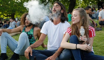 Israelis smoking cannabis on International Cannabis Day at a park in Jerusalem in front of the Knesset.