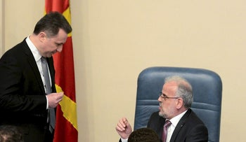 Nationalist politician and member of opposition party VMRO-DPMNE, Nikola Gruevski (L) argues with Parliament speaker Talat Xhaferi (C) during a parliament session in Skopje on March 14, 2018