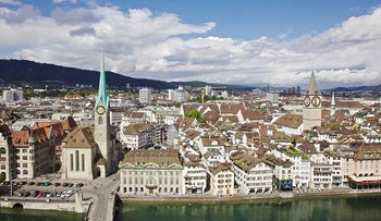 Residential and commercial properties are seen beyond the Limmat river in Zurich, Switzerland, on Monday, Aug. 8, 2011