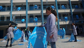 """FILE PHOTO: Refugee school girls hold kites to fly during the """"Kites of Dignity"""" event at the UNRWA Rimal Girls Preparatory school in Gaza City, March 12, 2018."""