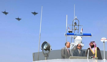 Saudi Crown Prince Mohammad Bin Salman (R) inspects investment projects with Egyptian President Abdel Fattah al-Sisi (C) in the Suez Canal at the city of Ismailia, Egypt, March 5, 2018,