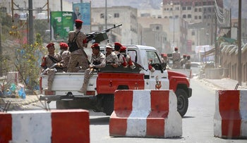 Yemeni military policemen patrol the streets of the city of Taez, on March 13, 2018