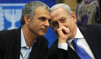 Moshe Kahlon and Benjamin Netanyahu during a Likud party meeting at the Knesset. October 15, 2012.