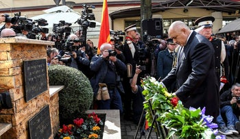 Bulgarian Prime Minister Boyko Borisov laying flowers at the memorial site during a ceremony in Skopje commemorating the 7,144 Macedonian Jews who died during the Holocaust, March 12, 2018.