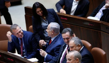Culture Minister Miri Regev shakes Prime Minister Benjamin Netanyahu's hand at the Knesset, March 13, 2018.