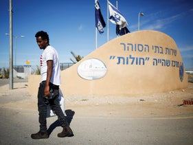 An African migrant walks outside the Holot detention centre in the Negev desert. March 13, 2018.
