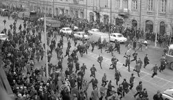 People fleeing police attacks near Warsaw University during the student riots, March 1968, Warsaw, Poland