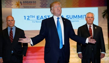 U.S. President Donald Trump makes remarks to the media as he stands alongside U.S. National Security Advisor H.R. McMaster (L) and former U.S. Secretary of State Rex Tillerson at the 12th East Asia Summit in Manila, Philippines November 14, 2017