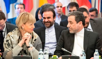Abbas Araghchi (R), political deputy at the Ministry of Foreign Affairs of Iran, and the Secretary General of the European Union External Action Service (EEAS) Helga Schmid talk as they meet for E3/EU+3 and Iran talks at Palais Coburg in Vienna, March 16, 2018.