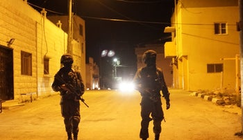 Israeli soldiers during a raid on the West Bank village of Barta'a, March 16, 2018.