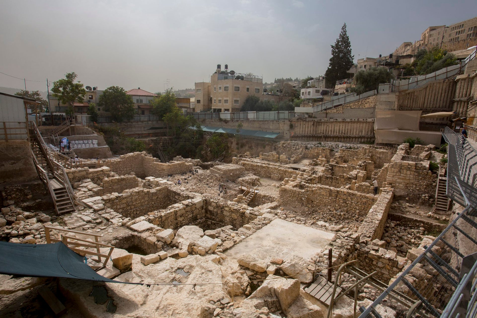 The 'City of David,' Jerusalem, below Temple Mount: Shown on backdrop of wintry sky, the photo shows extensive excavations and walls and rooms uncovered south of the Temple Mount. Behind them we see some modern residential buildings.