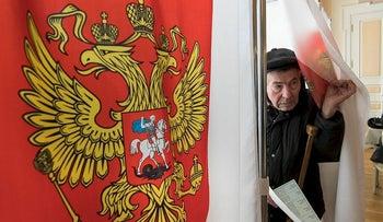 A man leaves a polling booth at a polling station during the Presidential elections in the Russian embassy in Vilnius, Lithuania, Sunday, March 18, 2018