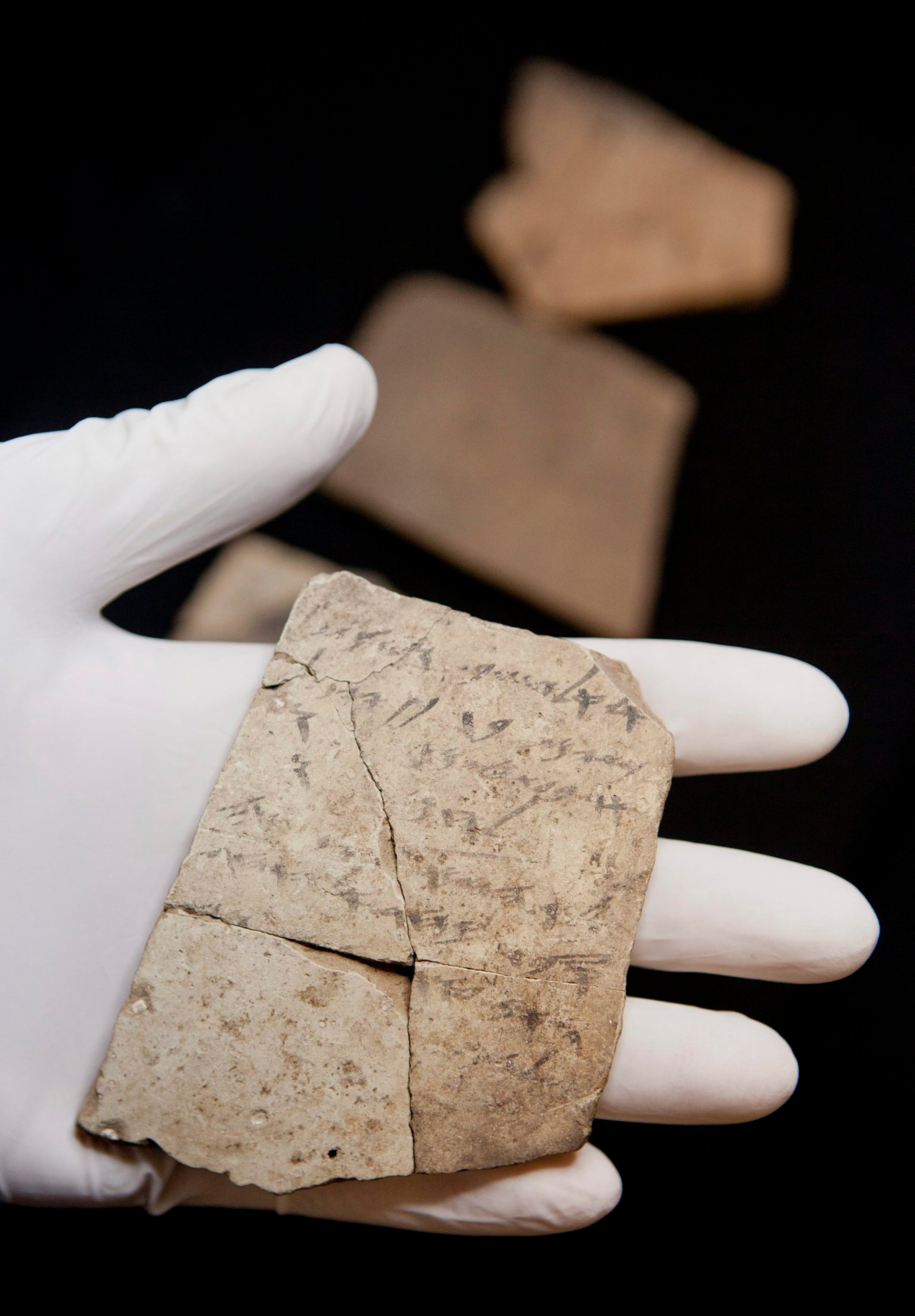 Writing on pottery, known as ostraca, unearthed in a fort in Arad, Israel, and dated to about 600 B.C.E., shortly before Nebuchadnezzar's destruction of Jerusalem, are seen in Israel Museum in Jerusalem Tuesday, April 12, 2016.