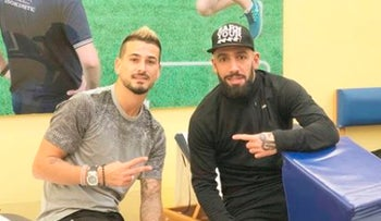 Maor Buzaglo and Iran's Ashkan Dejagah posing for a shot on posted on Buzaglo's Facebook page, March 18, 2018.