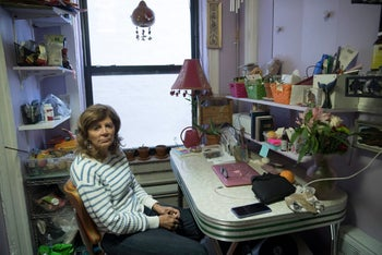 Mary Ann Siwek sits in her apartment, March 15, 2018. Kushner Cos. routinely filed false documents with NYC claiming it had no rent-regulated tenants in its buildings, including the one where Siwek lived.